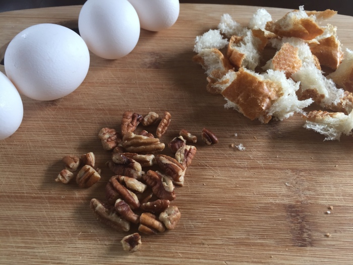 eggs, pecans, and torn bread pieces for bread pudding