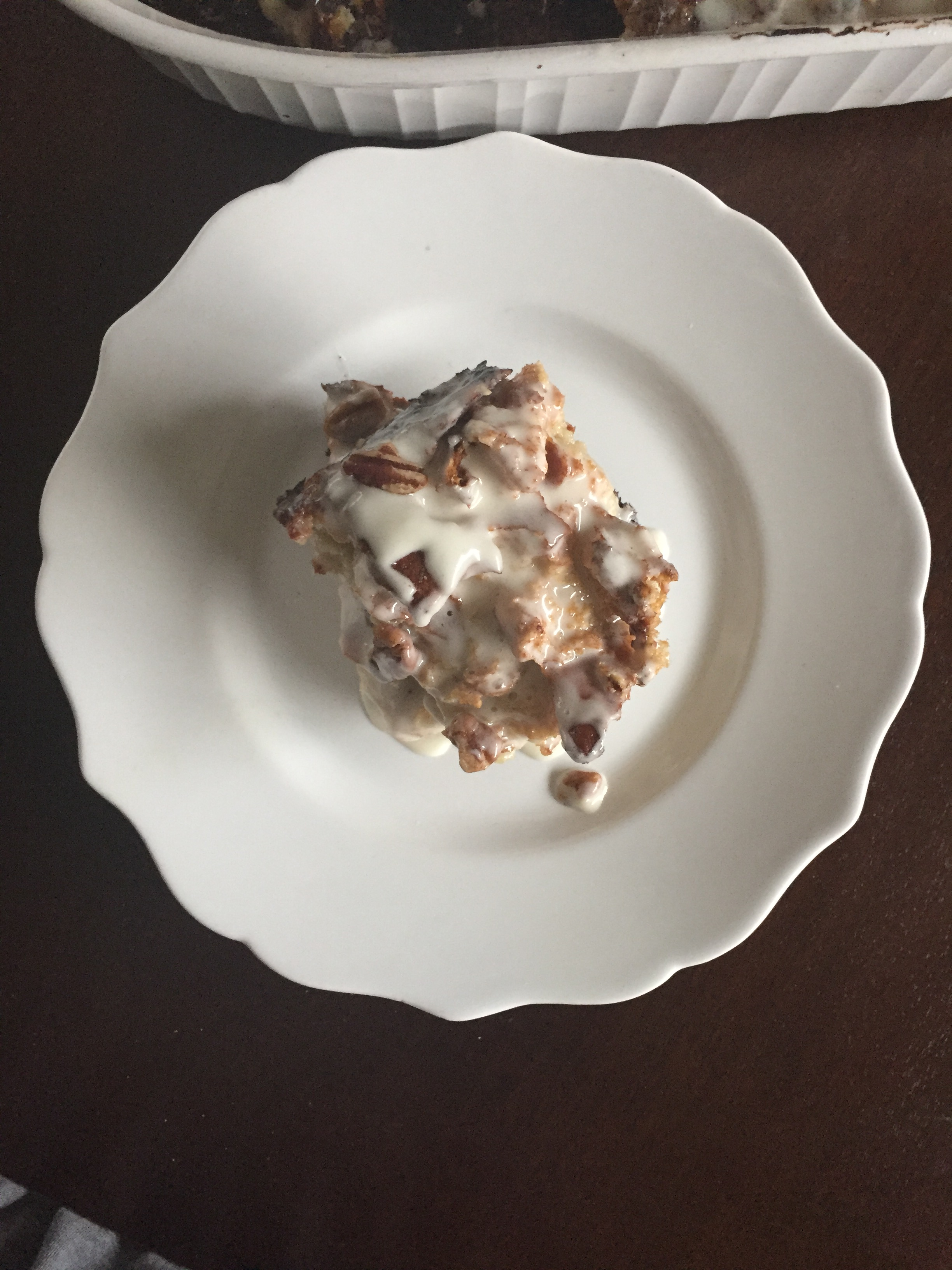 cinnamon roll bread pudding with frosting glaze over top