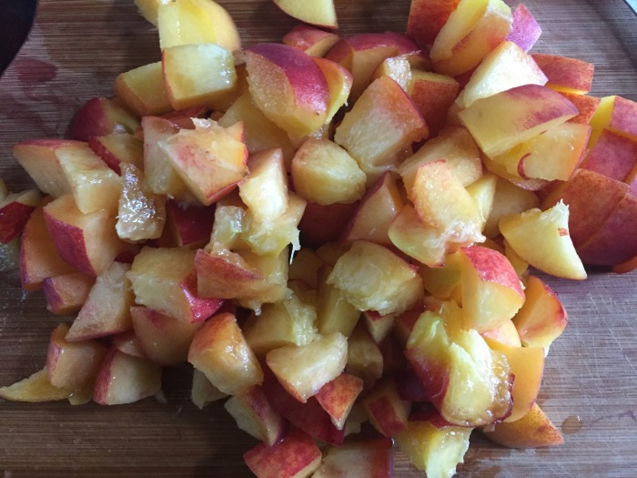 chopped peaches on cutting board